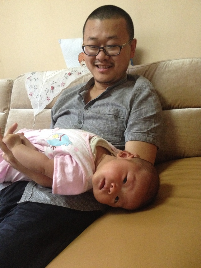 Zoë, our new born. The inconspicuous man behind her is Zhang Weiwu